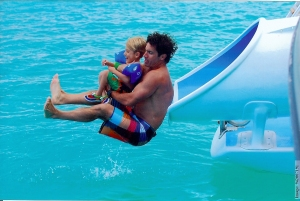 That's me with my dad on our vacation.  The slide was on the big boat and went right into the ocean!!